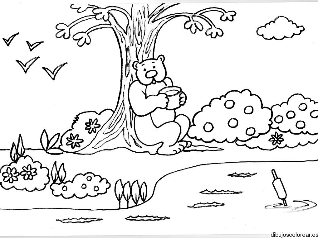Dibujo de un oso descansando bajo un árbol