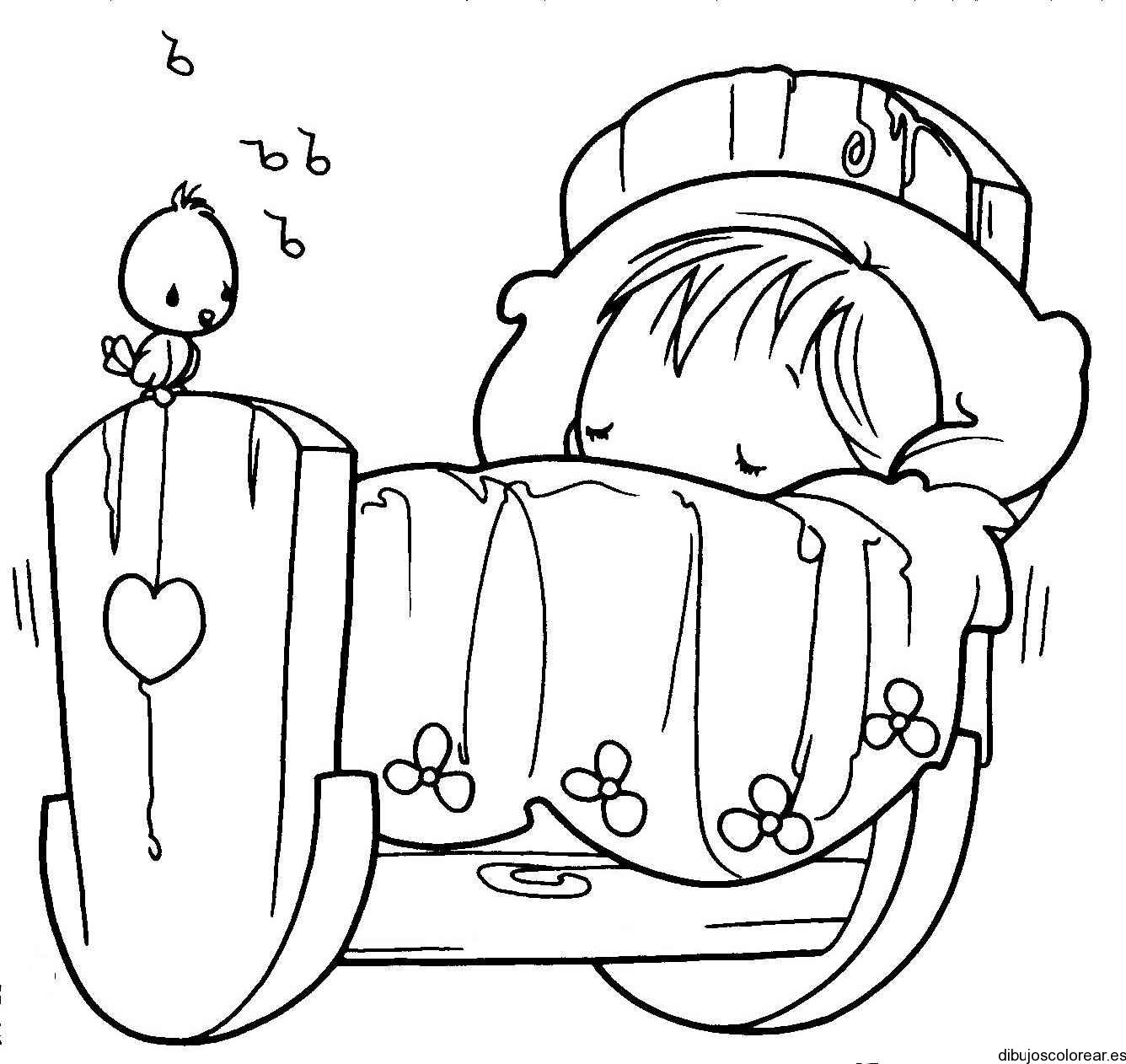 Dibujo de un bebé en la cuna